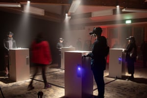 Viewers watching Real Violence by Jordan Wolfson, a violent virtual reality artwork, showing at Dark Mofo in 2019.