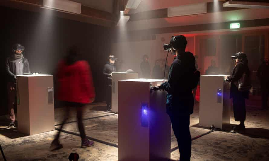 Viewers watching Real Violence by Jordan Wolfson at Dark Mofo in 2019.