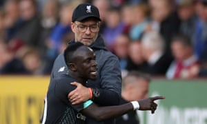 Sadio Mané is restained by Jurgen Klopp after the striker is substituted.
