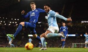 John Stones, left, and Manchester City's Raheem Sterling