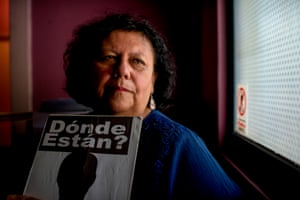 Lorena Pizarro, the daughter of Waldo Pizarro who disappeared in 1976, holds a 'Where Are They?' sign