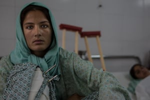 """Razia, 16, from Helmand Province, is recovering from her blast injuries in hospital. """"We were right in the middle of it all when fighting broke out between the Taliban and the government. The rockets were flying and one of them hit our house. I remember the pain and feeling my legs burn away, but that's when I lost consciousness. Two of my brothers and my sister were killed. I'm now recovering in hospital, but I'm afraid to go home. Fighting breaks out so often here, it's not safe."""""""