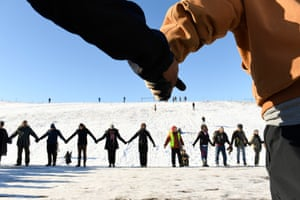 US veterans and Native Americans activists hold hands in prayer and solidarity at Standing Rock.