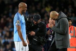 Pep Guardiola celebrates victory with Vincent Kompany.