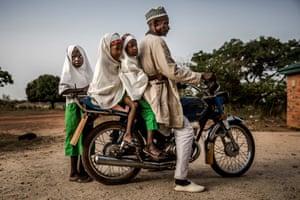 Fulani girls get a ride to school
