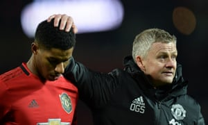Manchester United's manager Ole Gunnar Solskjaer gives Marcus Rashford a consoling  pat after the draw with Aston Villa.