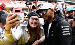 Lewis Hamilton poses for a photo at the Spanish Grand Prix. F1's new owners Liberty Media have made strides to improve the fan experience at races, and are a lot more aware of the sport's appeal through social media.