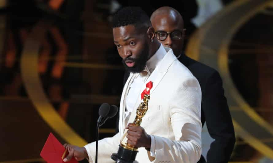 Tarell Alvin McCraney accepts an Oscar for Moonlight.