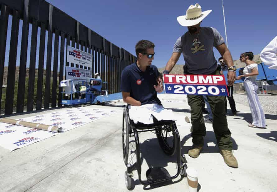 Brian Kolfage, left, and David Clarke Jr, a We Build the Wall board member, prepare for a news conference in Sunland Park, New Mexico.