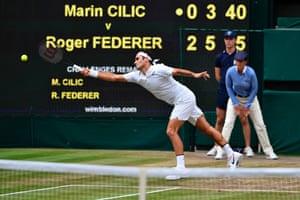 Roger Federer returns against Marin Cilic.
