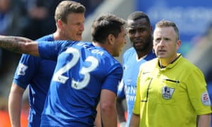 Leicester players give Moss a piece of their mind.