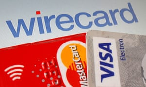 Mastercard and Visa credit cards in front of Wirecard logo