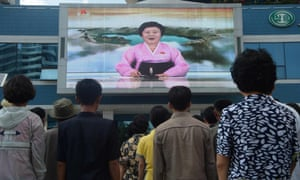 Residents watch a big video screen on Mirae Scientists Street in Pyongyang showing newsreader Ri Chun-Hee as she announces the news of the test.