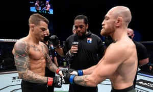 Opponents Dustin Poirier and Conor McGregor of Ireland face off prior to their lightweight fight.