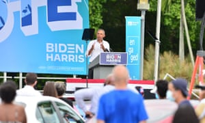 Obama speaks at a Biden-Harris drive-in rally at Florida International University, in North Miami, Fla.