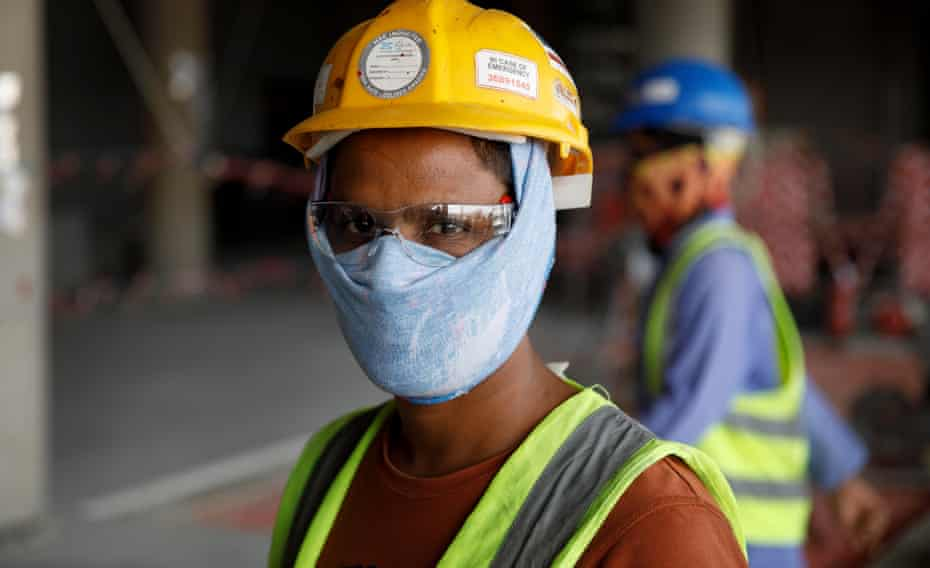 A migrant worker at the construction site for the al-Rayyan stadium.