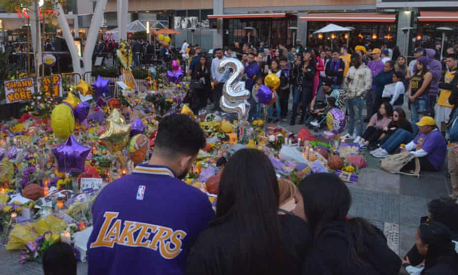 Fans gather around a memorial outside the Staples Center on Tuesday.