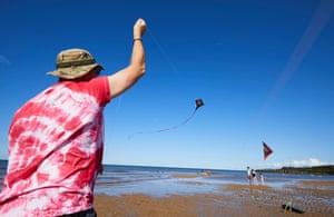 Kite flying on Lligwy Bay beach