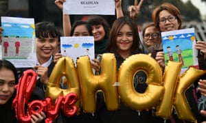 People attend a rally to show support for jailed former governor Basuki Tjahaja Purnama - known by his nickname Ahok.