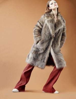 Fake fur coat, . Trousers, £399, karenwalker.com. Sneakers, model's own.
