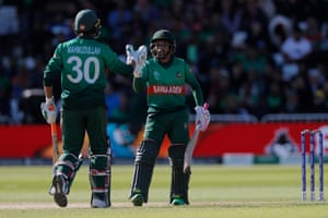 Bangladesh's Mushfiqur Rahim (right) is congratulated by Mahmudullah on his half century.