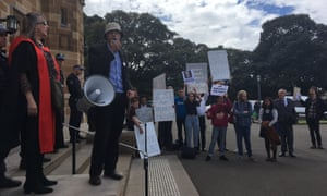Nick Riemer addresses the protest against John Howard's honorary doctorate outside the Great Hall at Sydney University on Friday.