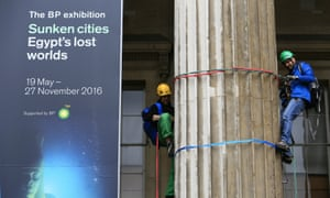 Greenpeace activists climb the British Museum in protest against BP's sponsorship.