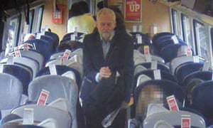 A CCTV image released by Virgin Trains showing Labour leader Jeremy Corbyn walking past empty, though reserved, seats on his journey from London to Newcastle on 11 August
