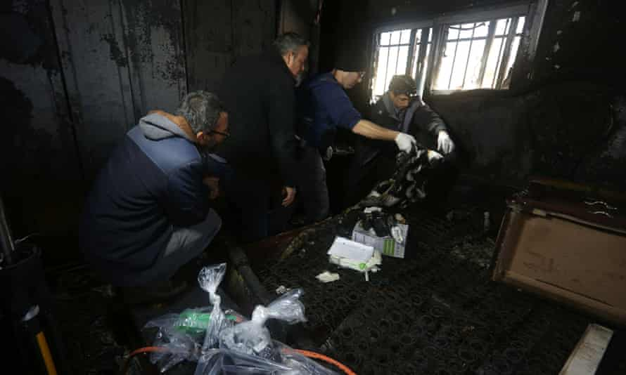 Israeli police inspect the burnt-out home of Ibrahim Dawabsha in Duma in the occupied West Bank