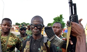 Mutinous soldier pose with their weapons in the streets of Ivory Coast's central second city, Bouake.