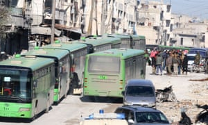 People board buses to be evacuated from east Aleppo.