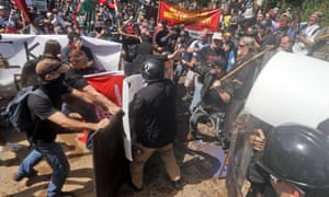 White nationalist demonstrators clash with counter demonstrators at the entrance to Emancipation Park in Charlottesville, Virginia on Saturday 12 August.