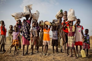 Families who have been displaced by ongoing fighting in South Sudan arrive with what few possessions they have at a rapid response mission in Thanyang, Unity state