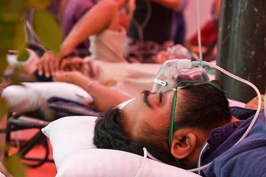 A Covid-19 coronavirus patient breathes with the help of oxygen provided by a Gurdwara, a place of worship for Sikhs on 6 May 2021.