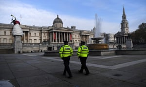 Police walk through London's Trafalgar Square in early November during England's second national lockdown.