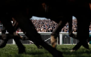 Spectators watching the first race of the day, the Gaskells Handicap Hurdle