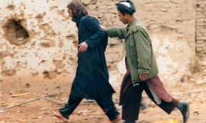 Lindh is led away after being captured among al-Qaida and Taliban prisoners in Afghanistan in December 2001.