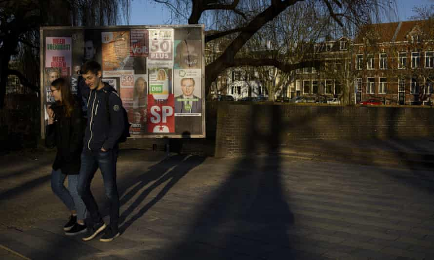 People pass election posters in Den Bosch, Netherlands