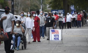 Voters wait in line to cast their ballot early in Augusta, Georgia