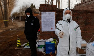 A Chinese Epidemic Prevention Officer investigates a site blocked due to African swine fever in the Beijing district of Tongzhou, China.