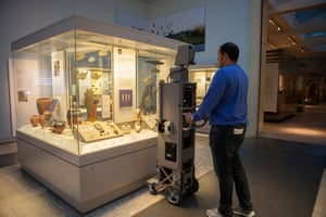 A Google employee photographs exhibits at the British Museum.