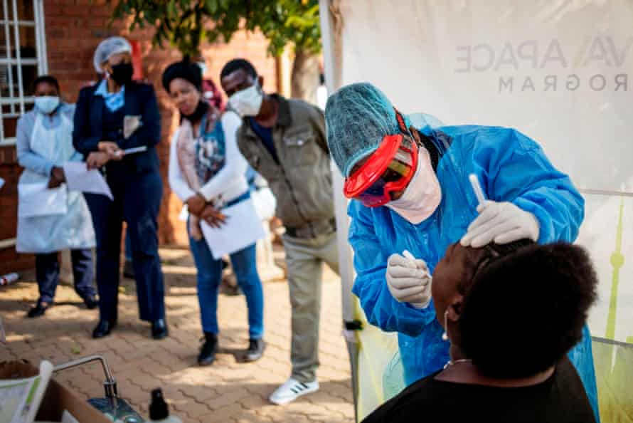 Nurse performs a swab test for Covid-19 on a health worker at the Vlakfontein Clinic in Lenasia, Johannesburg.