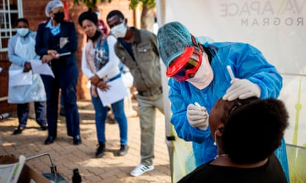 A Doctors Without Borders (MSF) nurse performing a Covid-19 swab test on a health worker at the Vlakfontein Clinic in Lenasia, Johannesburg, in May 2020