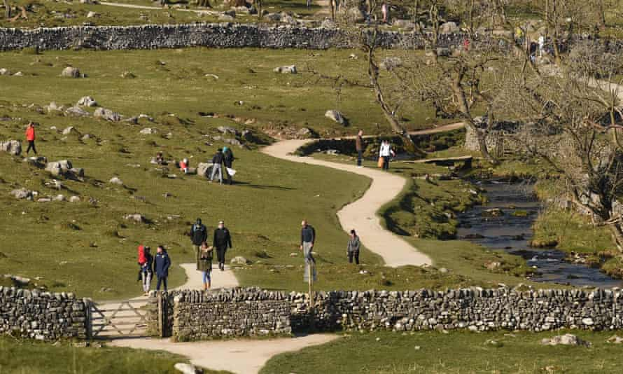 People visiting Malham Cove in North Yorkshire in March