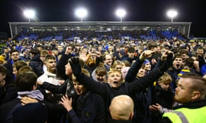 Shrewbury fans invaded the pitch after securing a replay against Liverpool and their manager Sam Ricketts said the money could 'change the club's future'.