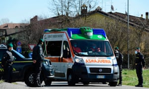 An ambulance at a check-point at one of the entrance of the small town of Zorlesco, south-east of Milan.