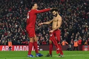 Mohamed Salah celebrates scoring Liverpool's second goal with Virgil van Dijk