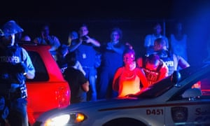 <strong>Missouri, US</strong> A demonstrator is arrested during a protest marking the first anniversary of the shooting of Michael Brown along West Florissant Street in Ferguson