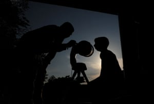 An instructor teaches an astronomy enthusiast how to use a telescope at the Birla planetarium in Chennai, India