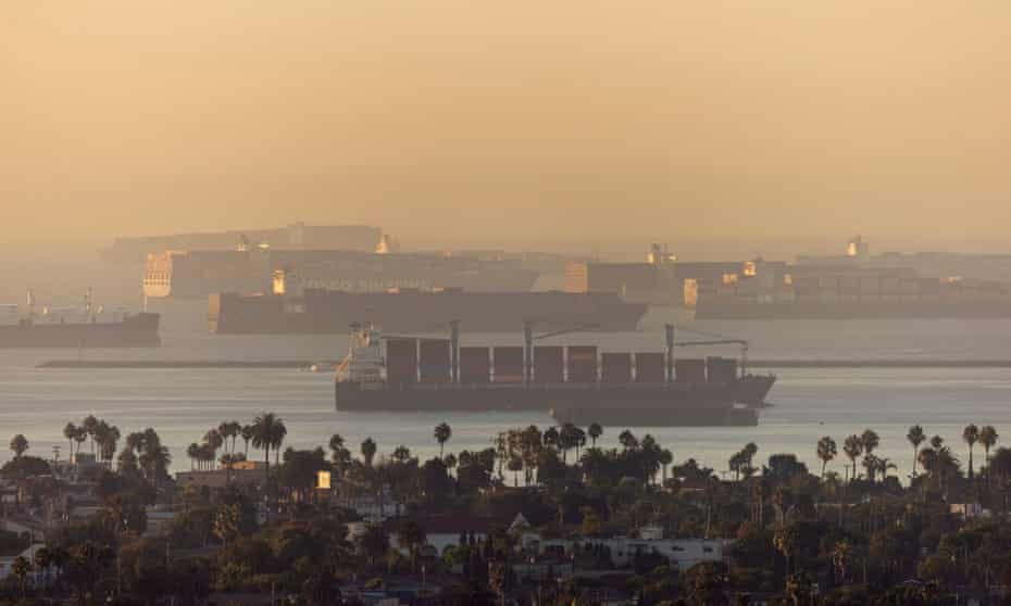 Container ships sit in the ocean waiting to unload their cargo at the ports of Los Angels and Long Beach on 22 September.